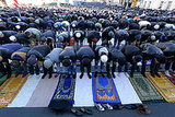 Russian Muslims prayed together outside Moscow's central mosque for Eid al-Adha.