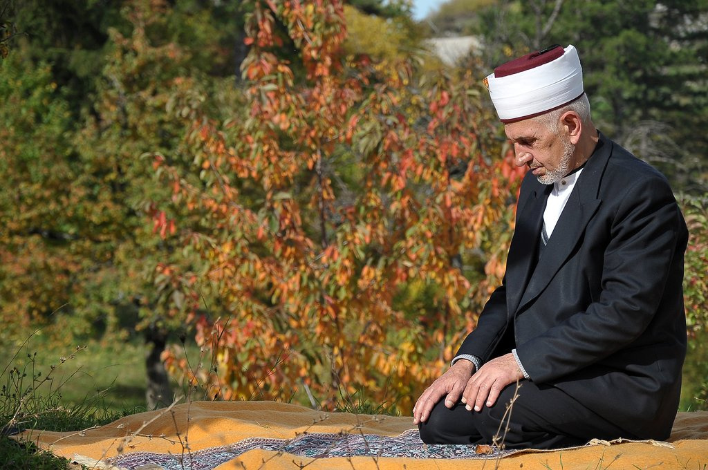 A man in Bosnia prayed outside for Eid al-Adha.