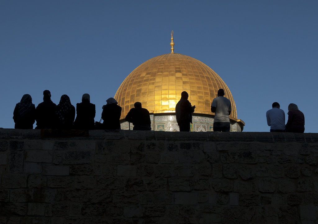 In Jerusalem, Palestinian worshippers sat beside the golden dome inside the Al-Aqsa Mosque compound after morning prayers.