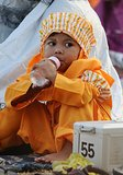 A child played while people prayed for Eid al-Adha in Surabaya, Indonesia.