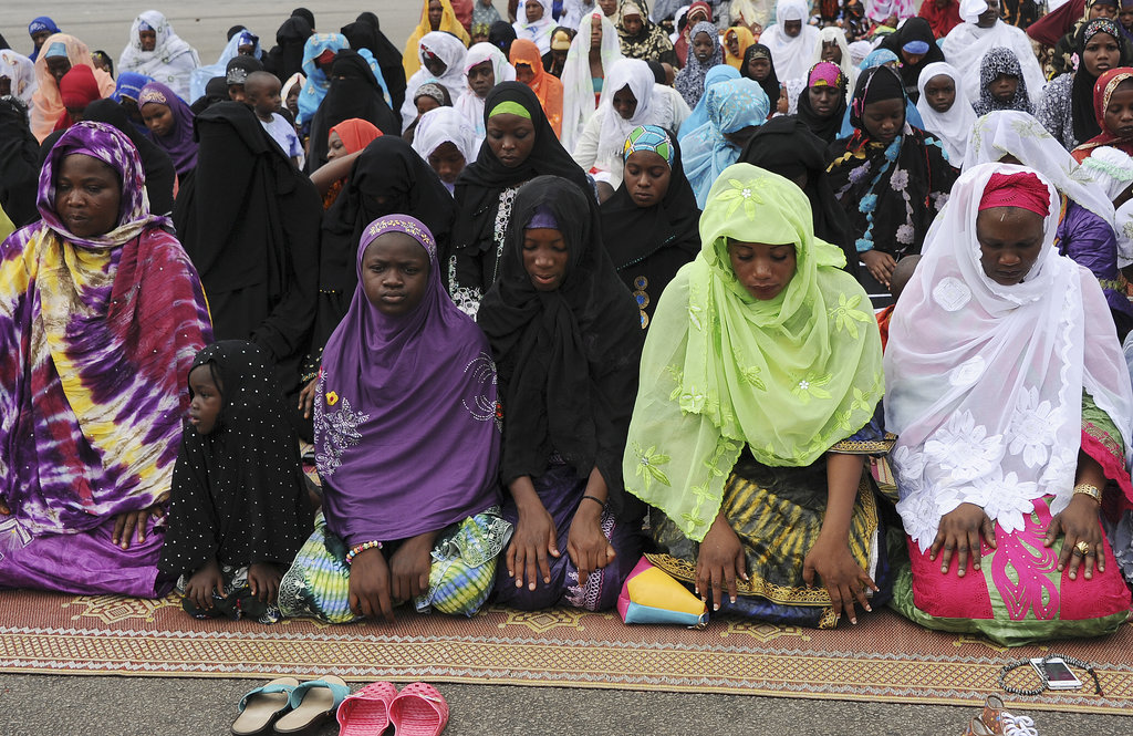 People on the Ivory Coast knelt in prayer for Eid al-Adha.