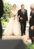 Max (Ryan O'Neal) walks Brennan down the aisle.
