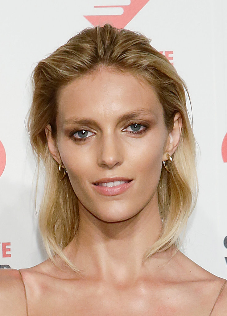 A brushed-back hairstyle and bronzy shadow looked beautiful on model Anja Rubik.