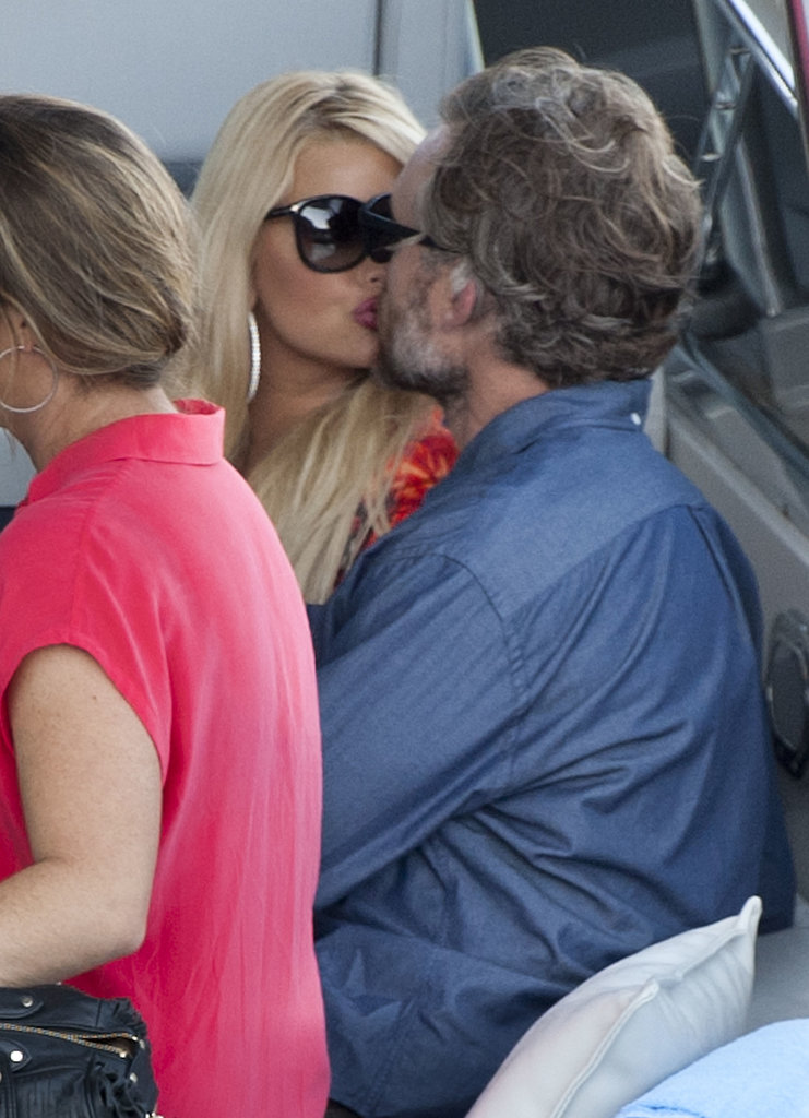Jessica Simpson gave Eric Johnson a kiss on a boat.