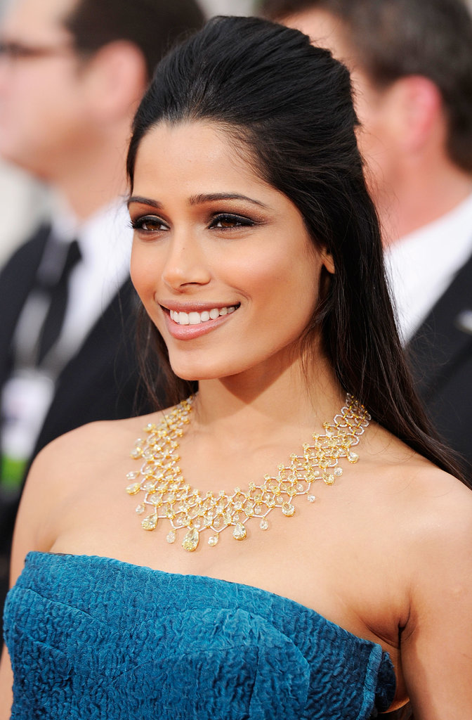 At the Golden Globe Awards in 2012, Freida forewent her typical upsweep for a half-up hairstyle, but we can still consider that an pseudo-updo, right?