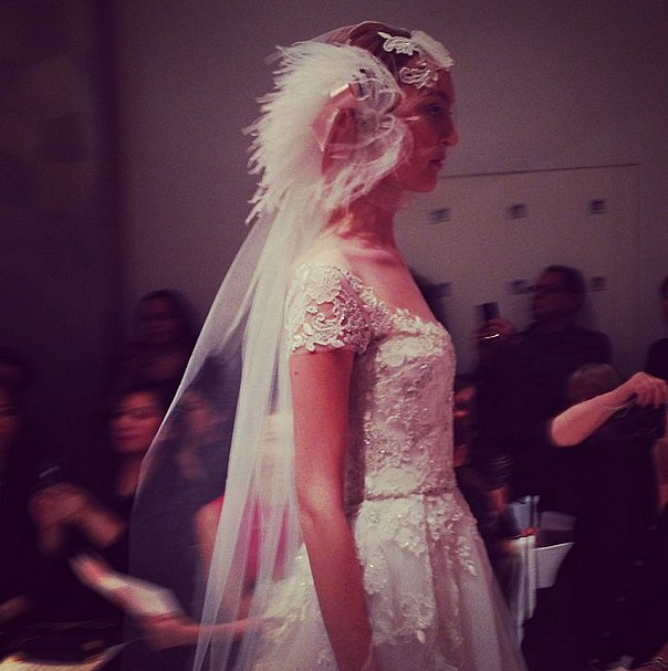 Feathered headpieces floated down the Reem Acra bridal runway.