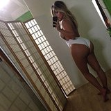 Kim Kardashian flaunted her postbaby figure in a white swimsuit in October 2013. Source: Instagram user kimkardashian