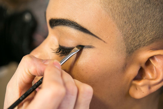Next, use a liquid liner — Bouchard went with Penultimate Liner ($20) — to line your eyes. Extend the line past the outer corner to ultimately connect to the tip of your brow. Go back with the same black powder to intensify the look. Source: Caroline Voagen Nelson