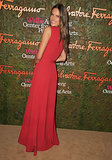 Alessandra Ambrosio displayed her cascading crimson dress for photographers.