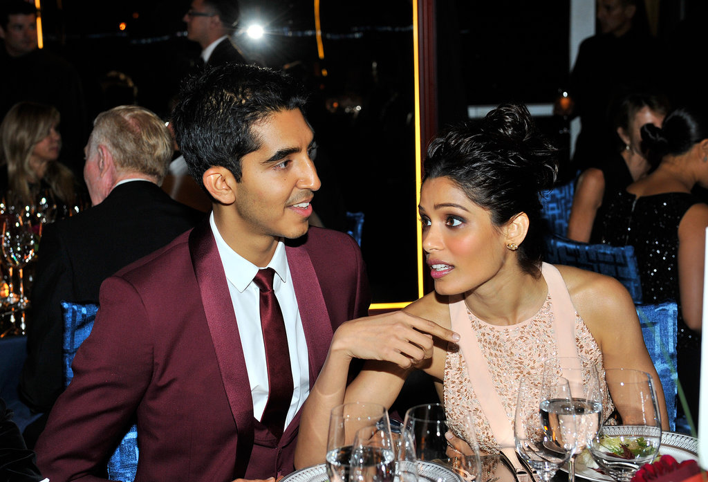Dev Patel and Freida Pinto chatted during the Annenberg Gala over dinner and drinks.