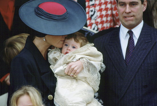 Sarah, Duchess of York, gave Princess Eugenie a kiss while Prince Andrew looked on after their daughter's christening at Sandringham Church on Dec. 23, 1990.