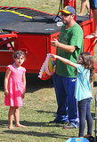 Adam Sandler went to check out the Corn Festival in LA on Sunday with his daughters, Sadie and Sunny.