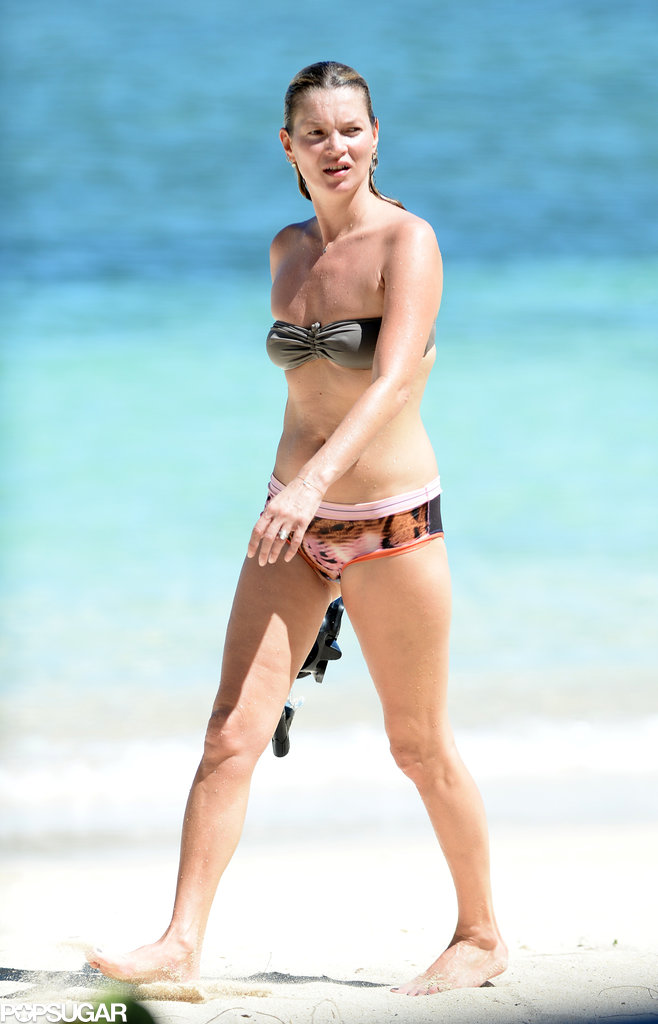 Kate Moss rocked a mismatched bikini while taking a dip in the ocean in Jamaica.