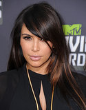 At the MTV Movie Awards, Kim opted for a sleek, sideswept blowout with her signature nude lips.