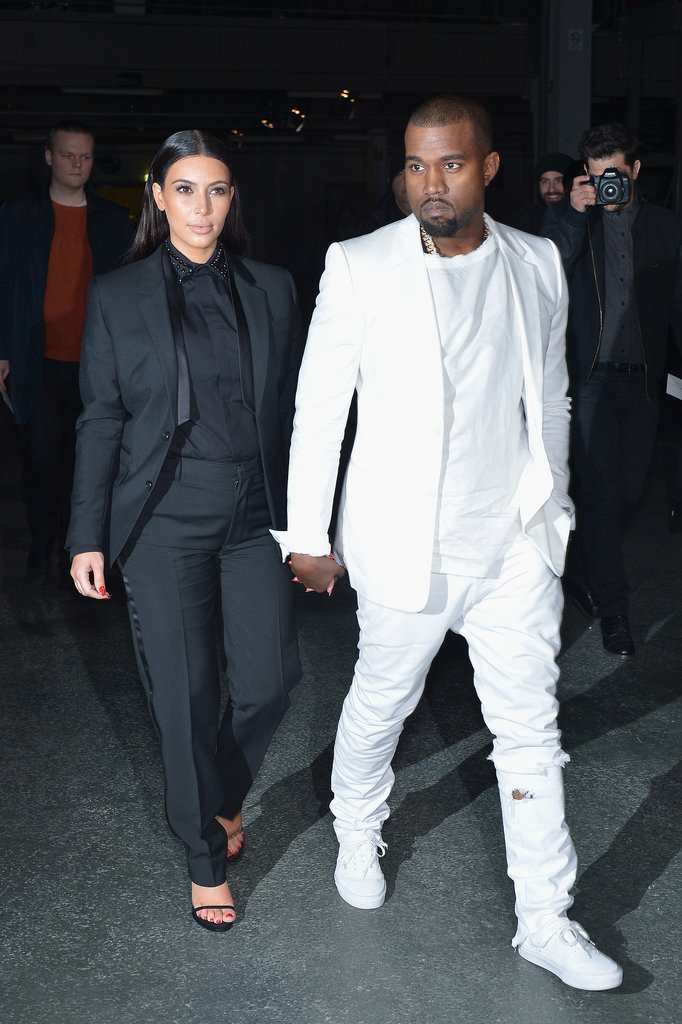 The couple that dresses together stays together! Kim and Kanye made one of soon-to-be many Givenchy-clad appearances for the label's Fall 2013 runway show.
