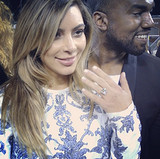 Kim's hairdresser shared a photo of Kim and Kanye right after Kanye popped the question in October 2013. Source: Instagram user clydehairgod