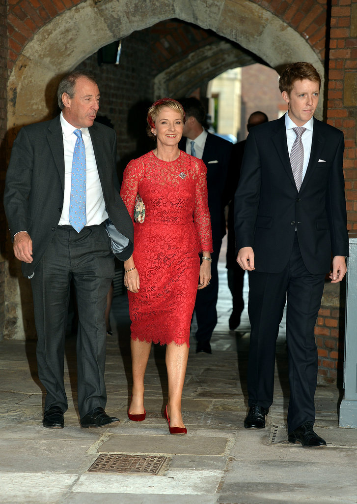 Michael Samuel and godparents Julia Samuel and Earl Grosvenor left the ceremony.