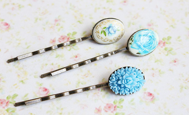 Vintage cameo bobby pins from Etsy ($20) are easy, functional, and affordable last-minute additions. Or, you can look for fascinators and brooches to incorporate the color into your wedding-day hairdo.