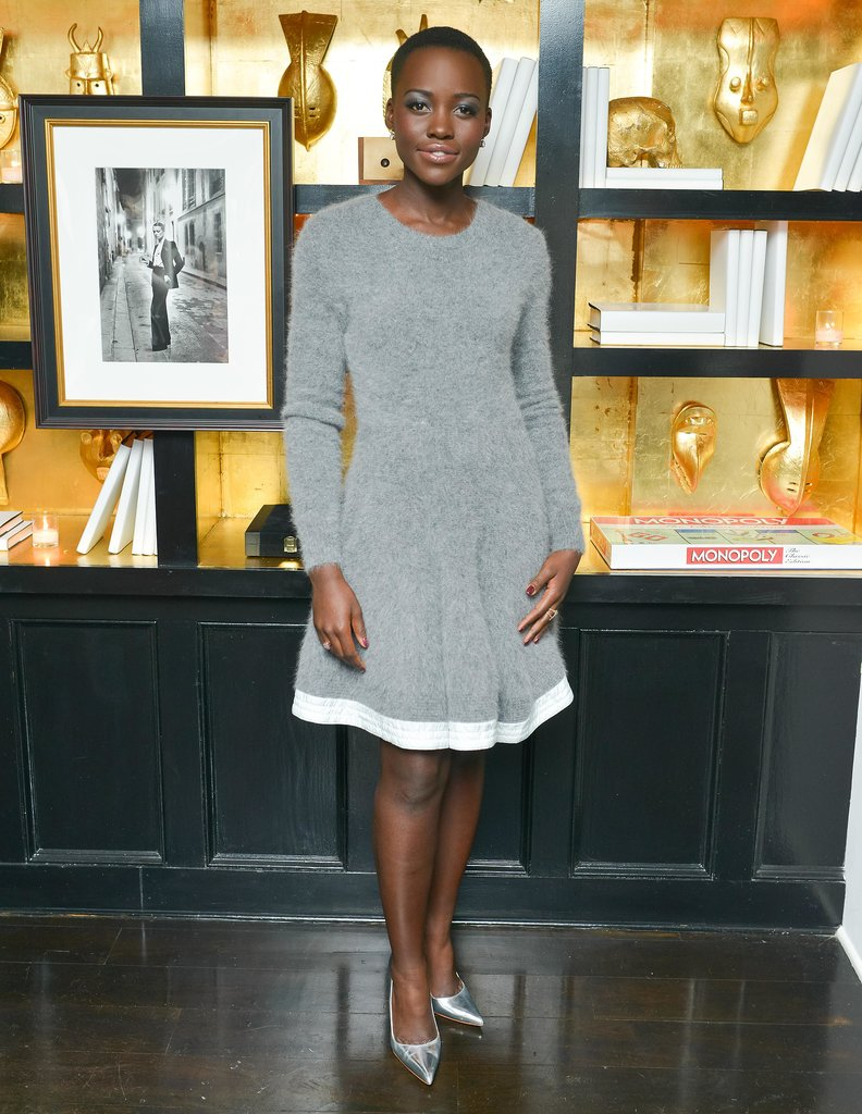 Lupita Nyong'o added surprisingly sexy mirrored pumps to her cozy gray Sacai dress at a Barneys New York dinner party.