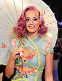 Dressed like a modern geisha at the 2011 MTV Video Music Awards, Katy opted for a shocking pink hair color that complemented her pastel ensemble.