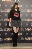 Hailee gave a lot of lip in a cheeky sweater, which she styled with a flirty skirt and knee-high boots by Stuart Weitzman while touring in Spain.