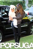 Alessandra Ambrosio dressed as a cat while taking little Noah out for a trick-or-treating excursion in LA.