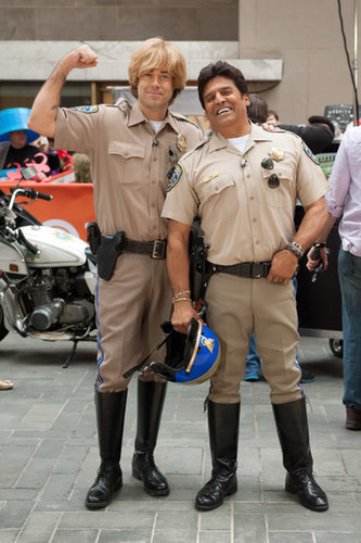 Carson Daly and Erik Estrada donned CHiPs outfits in 2013.