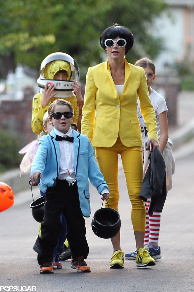"Julie Bowen dressed up as Psy's sidekick from his ""Gangnam Style"" video to match with her son."