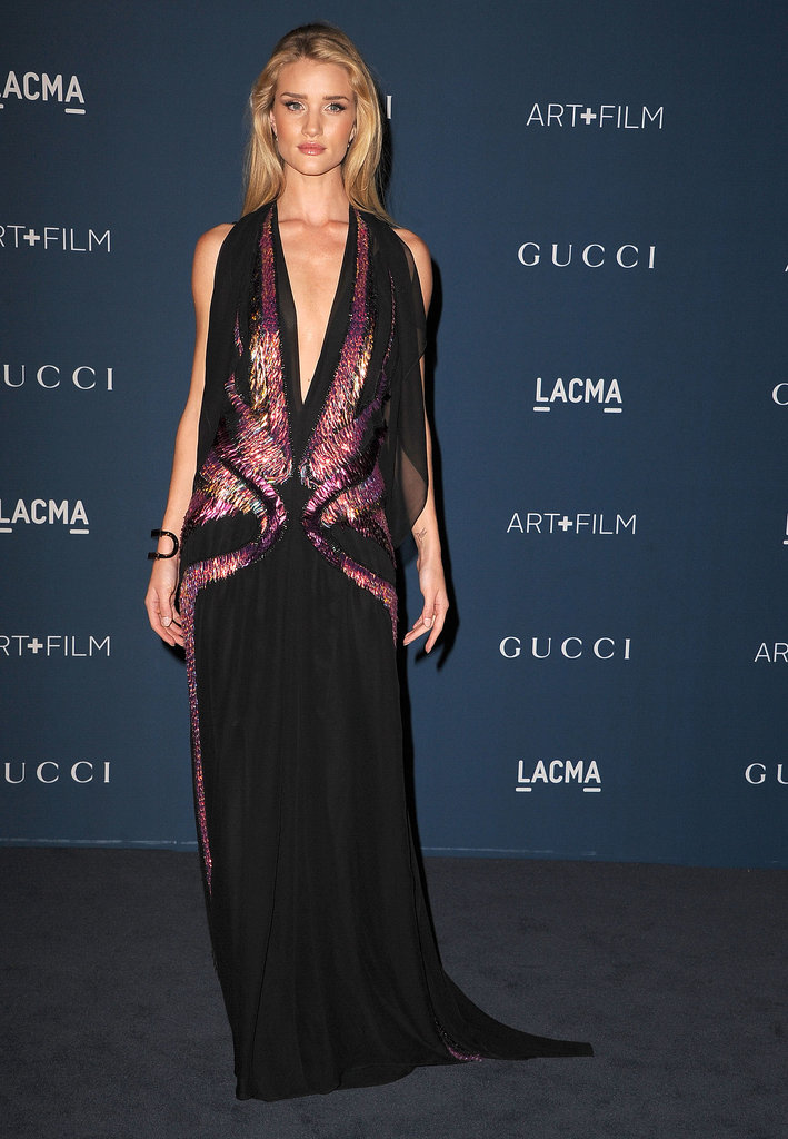 Rosie Huntington-Whiteley wore a black chiffon Gucci halter gown with pink embroidery along a plunging bodice.