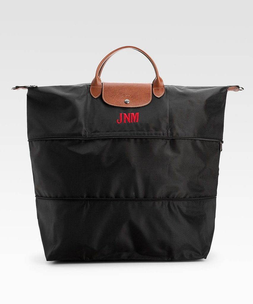 What to gift the weekend warrior in your life? If someone's been nursing a travel bug for a while now, replace their beat-up duffel with a durable nylon Longchamp tote ($255) with a classy monogram.