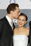 Tom Hiddleston surprised Natalie Portman with a peck.