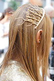 Go seasonal à la Anna Dello Russo, and slide some branches into your hair.