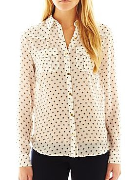 Liven up a pair of basic slack with this MNG by Mango print blouse ($30).