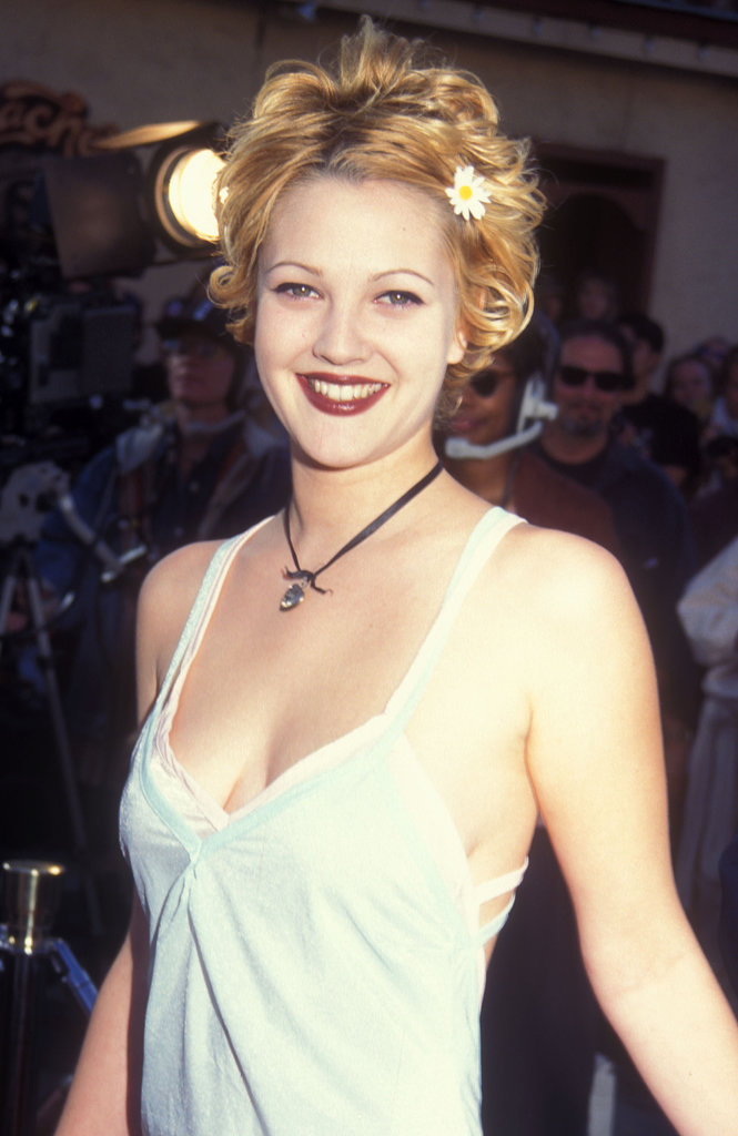 When you think of Drew Barrymore in the '90s, you can't help but think of her bleached-blond pixie, daisy hair pin, and brick-red lipstick.
