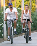 Leonardo DiCaprio rode a bike through Spain with his rumored girlfriend, Toni Garnn, in August 2013.