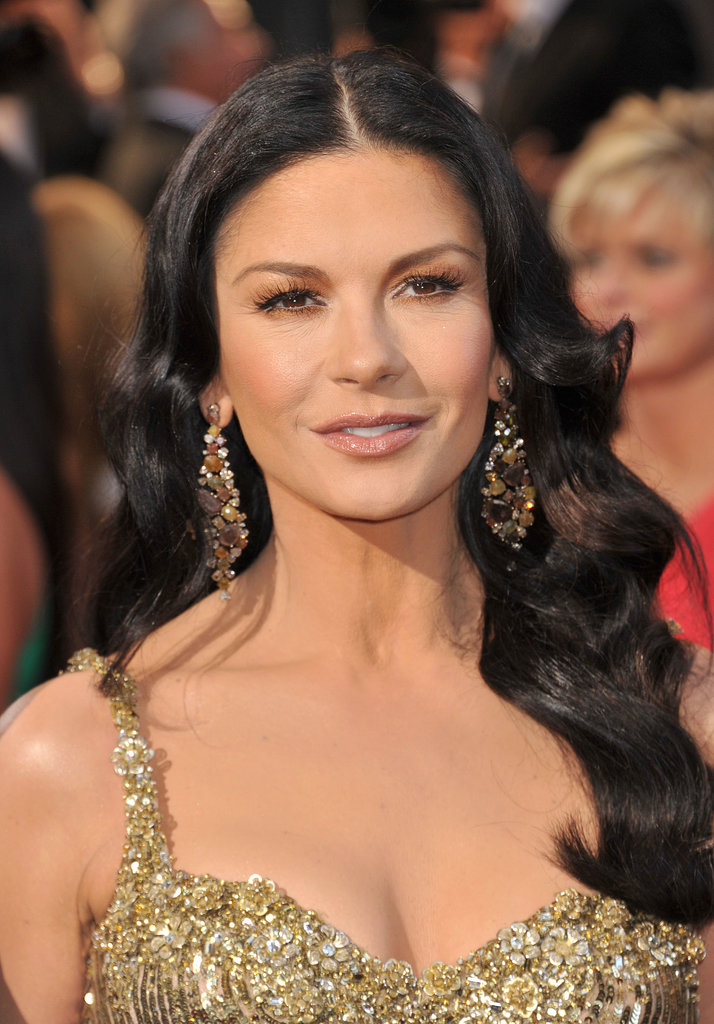 If your earrings are large enough, like these from Catherine Zeta-Jones, you can just style your hair in vintage waves and call it a day.