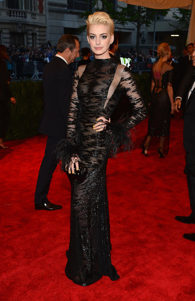The actress oozed dark glamour in a sultry, sheer vintage Valentino on the 2013 Met Gala red carpet.