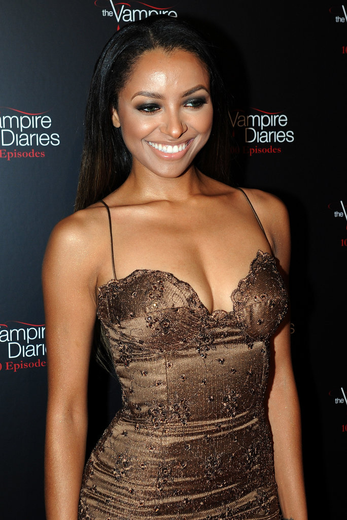 At the celebration of The Vampire Diaries' 100th episode, Kat Graham opted for slick, straight hair and heavy eye makeup.