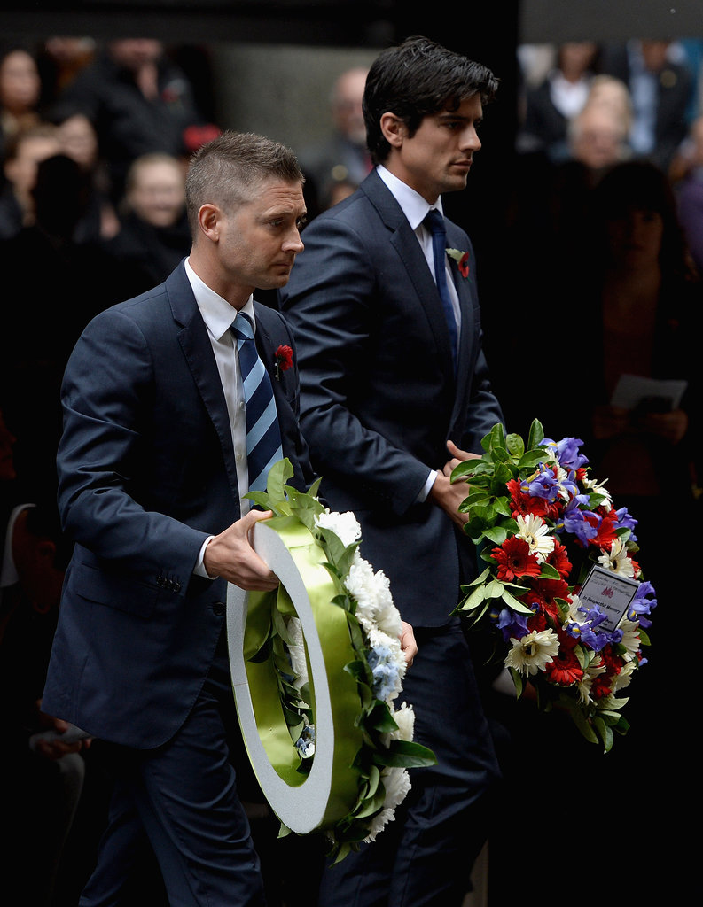Australian and English cricket captains Michael Clarke and Alastair Cook laid flowers during a Remembrance Day service in Sydney, Australia.