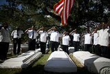 Military veterans offered a salute during a ceremony at the Grove Bahamian Cemetery in Coconut Grove, FL.