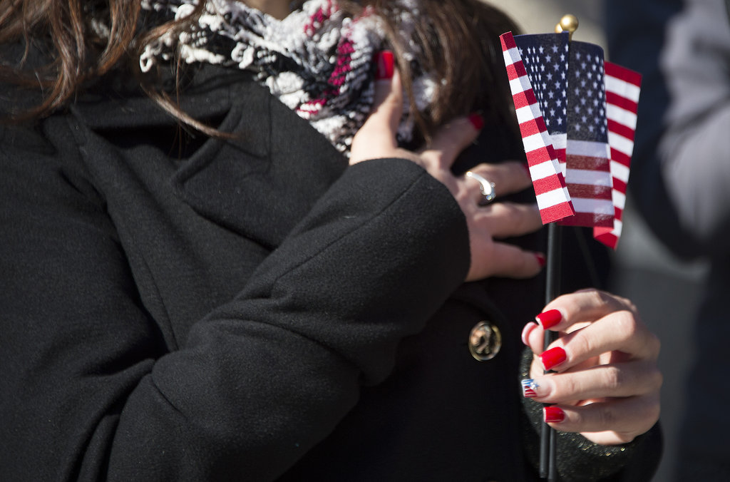 A woman held an American flag during the ceremony at Arlington National Cemetery.