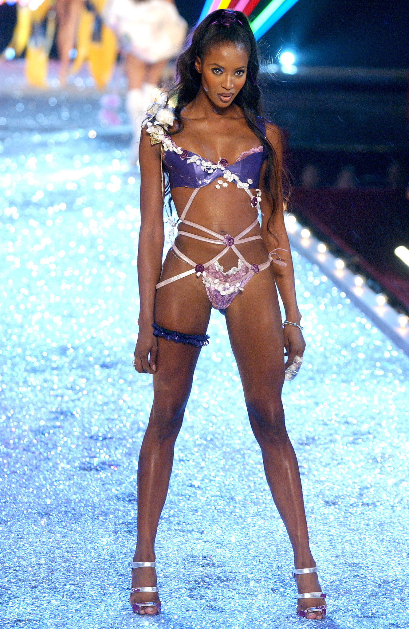 Naomi Campbell wore a bright purple, barely-there look on the 2003 runway.