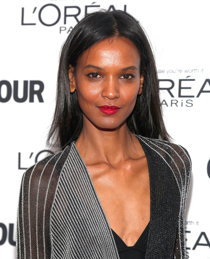 Liya Kebede wore her hair down and straight for the event, and she added a classic red lip hue to dress up her look.