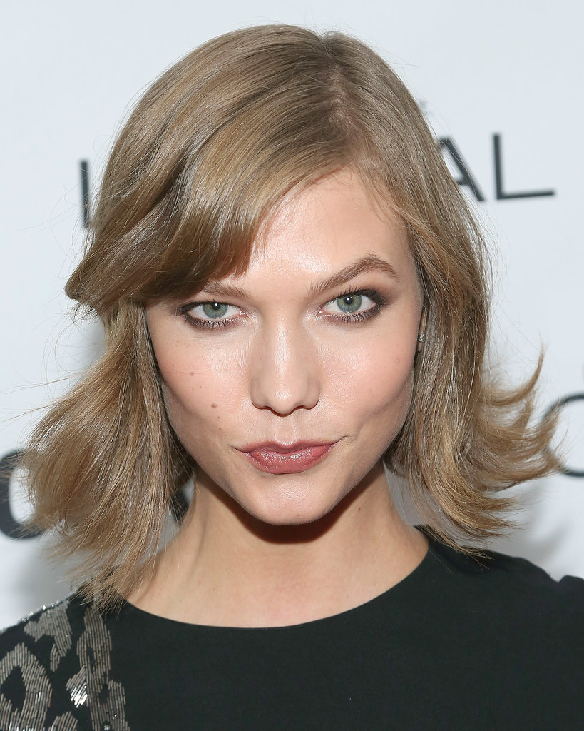 Karlie Kloss stuck to natural tones on the Glamour red carpet with a touch of metallic brown shadow under her eyes and a soft neutral on her lips. She wore her bob styled with flipped-out waves.