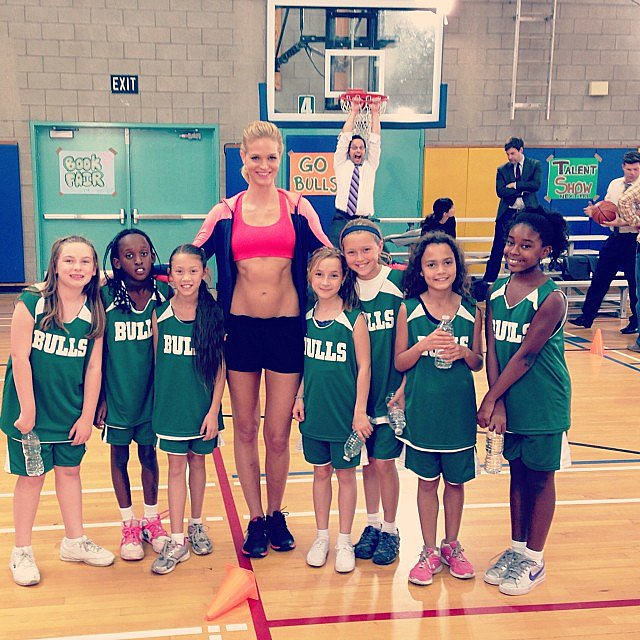 Erin Heatherton posed with her onscreen girls' basketball team after filming an episode of The League — yes, that's Nick Kroll getting some air on the hoop behind her! Source: Instagram user erinheathertonlegit