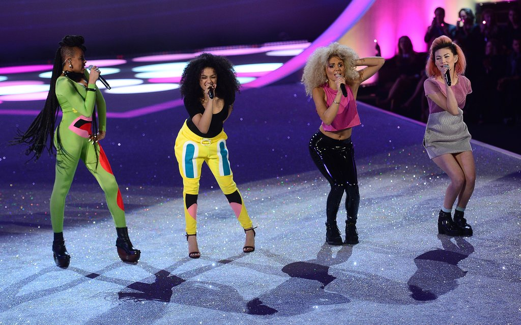 The members of Neon Jungle performing on stage.