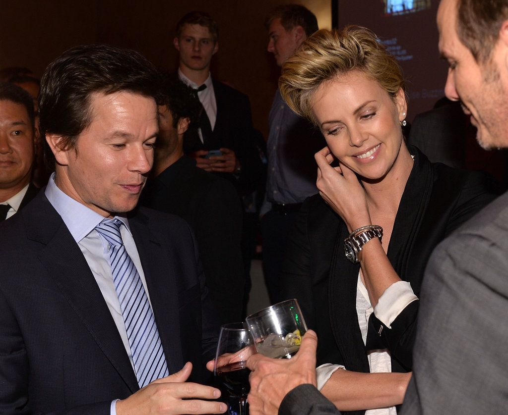 Charlize Theron mingled with Mark Wahlberg at the AFI Film Festival's premiere of Lone Survivor in LA on Tuesday night.