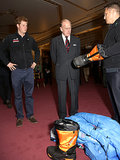 Prince Philip inspected boots while Prince Harry watched on.