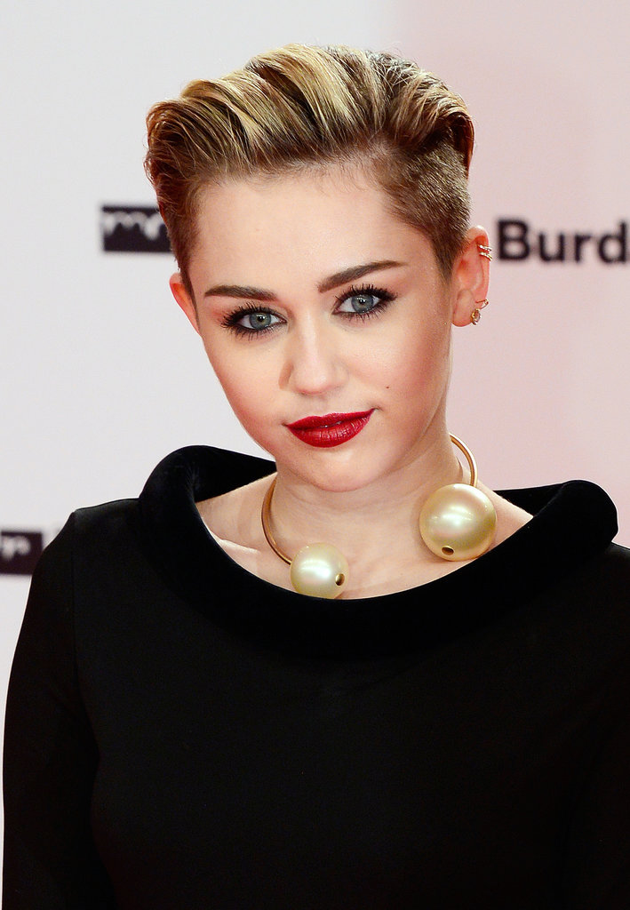 Miley Cyrus looked the right amount edgy and elegant with slicked-back hair and bright red lips.