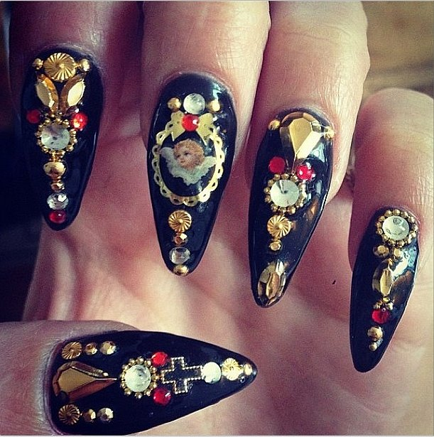 We love Vanessa Hudgens's artist angel manicure. Source: Instagram user vanessahudgens